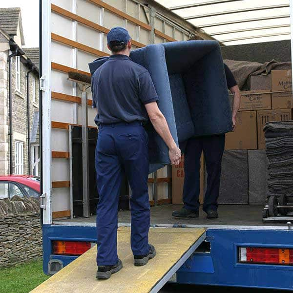 Removal men loading lorry