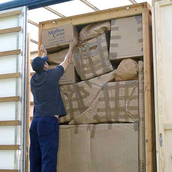 Packing items into containerised storage unit