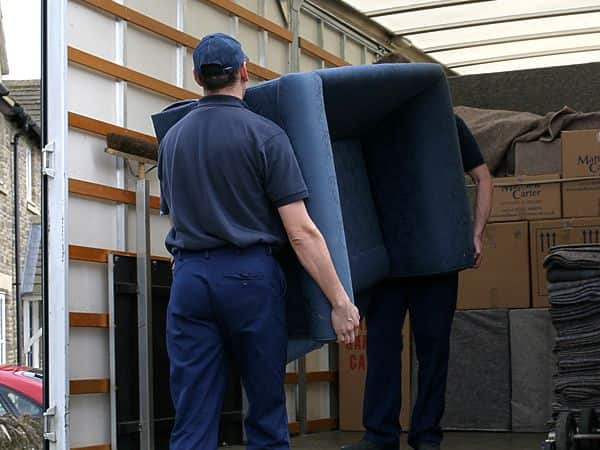 Crew loading sofa onto lorry